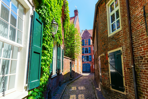 Photo Stands Narrow alley picturesque alley in Leer, Ostfriesland, Germany