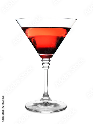 Glass of martini cocktail on white background