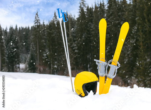 Ski equipment in snow outdoors, space for text. Winter vacation