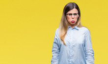 Young Beautiful Business Woman Wearing Glasses Over Isolated Background Depressed And Worry For Distress, Crying Angry And Afraid. Sad Expression.