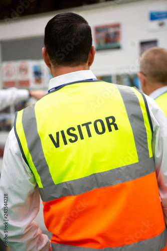 Photo Visitors wearing PPE in a manufactoring plant
