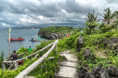Slika na platnu Panorama landscape azure sea and a tourist boat near Crystal Cove small island n