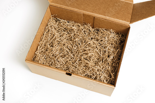 Brown shredded paper for gifting and stuffing in cardboard box Tapéta, Fotótapéta
