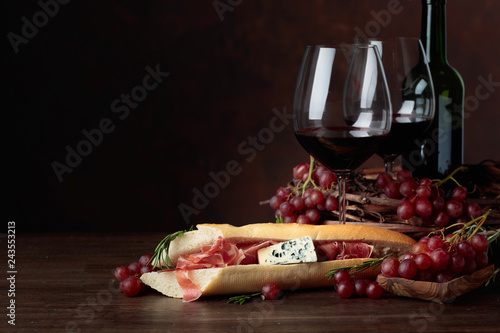 Delicious snack and glasses of red wine.