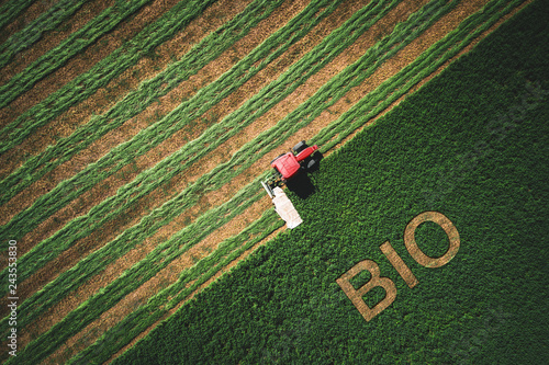 Bio concept and  tactor mowing green field Wallpaper Mural