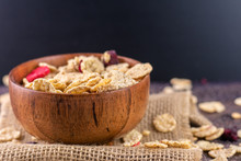 Muesli In Brown Bowl And Black Background