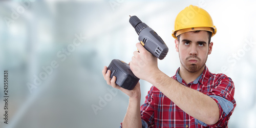 Photo  constructor with drill, renovations, repairs and bricolage