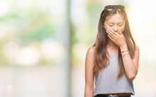 Young Asian Woman Wearing Sunglasses Over Isolated Background Bored Yawning Tired Covering Mouth With Hand. Restless And Sleepiness.
