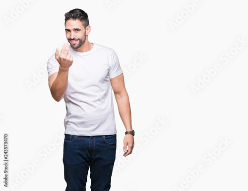 Cuadros en Lienzo  Handsome man wearing white t-shirt over white isolated background Beckoning come