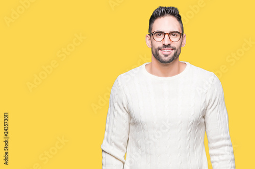 Fotografie, Obraz  Young handsome man wearing glasses over isolated background with a happy and cool smile on face