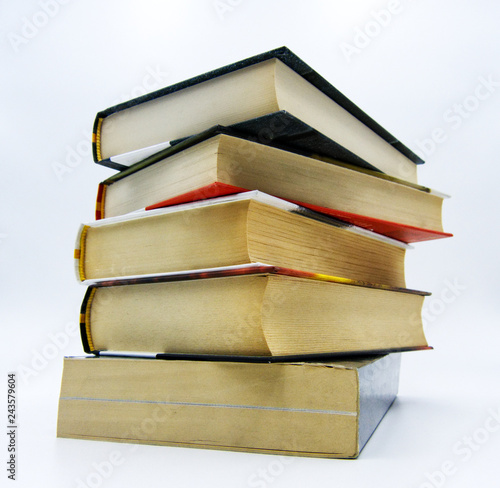 Fotografía  Pile of books on a table in white background