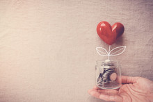 Hand Holding A Jar Of Heart Tr...