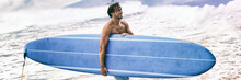Surfer Coming Out Of Ocean Walking In Waves After Surf Session Surfing Lifestyle In Maui, Hawaii, USA Banner Panorama. Man Standing With Blue Longboard Surf Board. Active Beach Watersport Lifestyle.