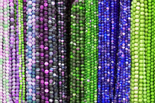 Colorful Beads Background. Background Pattern Of Multicolored Natural Stone Beads. String Of Beads In Various Colors. Colorful Beads Necklaces. Handicraft Fashionable For Women