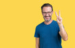 Handsome middle age hoary senior man wearin glasses over isolated background showing and pointing up with fingers number two while smiling confident and happy.