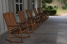 Wooden Rocking Chairs In A Row