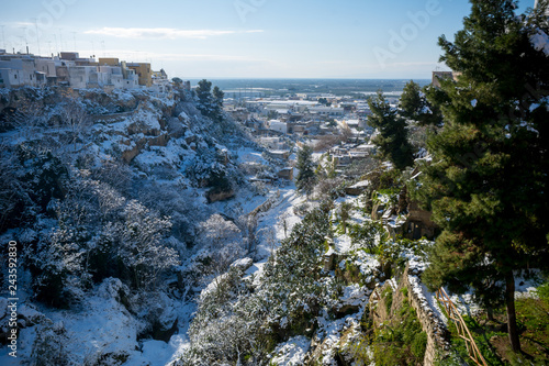 Fotografie, Obraz  Horizontal View of the Gravina of the Town of Massafra, Covered by Snow on Blue