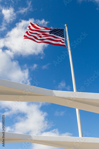 Photo  Stand Tall - The Stars and Stripes proudly waves over the USS Arizona Memorial
