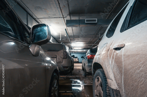 Fotografía  Cars in underground illuminated car parking