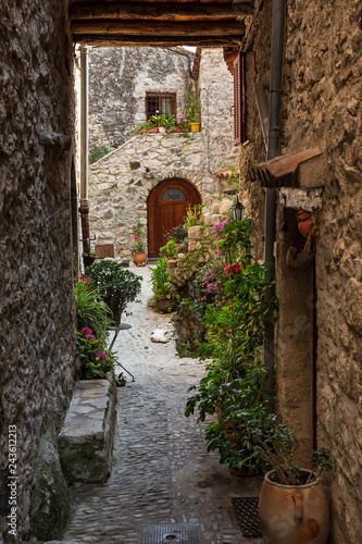 Fototapety, obrazy: The stunning narrow cobblestone streets of the beautiful hilltop village of Peillon in the Alpes-Maritime department of southeastern France