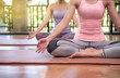 Close up, Young couple woman practicing yoga, sitting on mat in Ardha Padmasana exercise, Half Lotus pose, working out, meditation session at window with garden view. - Image