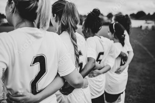 Female football players huddling together