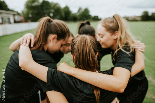 Rugby players huddle before a match