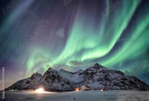 Poster Aurore polaire Aurora borealis with starry over snow mountain range with illumination house in Flakstad, Lofoten islands, Norway