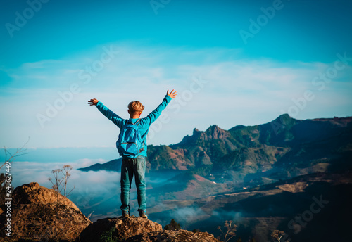 happy young boy enjoy travel hiking in mountains