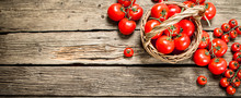 Ripe Tomatoes In A Basket.