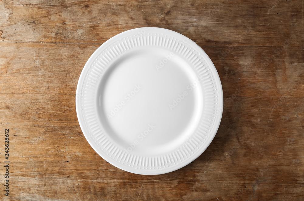 Fototapety, obrazy: Empty ceramic plate on wooden background