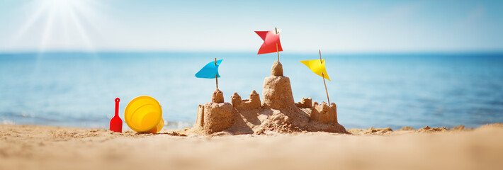 Sandcastle on the sea in summertime