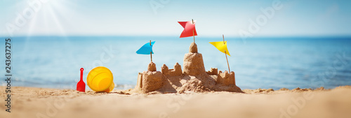 Obraz Sandcastle on the sea in summertime - fototapety do salonu