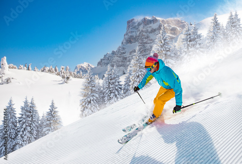 obraz dibond Skier skiing downhill in high mountains