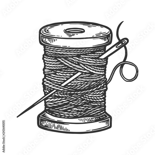 Photo Spool of thread and needle engraving vector illustration