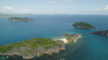 Aerial View Island With Sand Beach And Turquoise Water In Blue Lagoon Among Coral Reefs, Caramoan Islands, Philippines. Landscape With Sea, Tropical Beach.