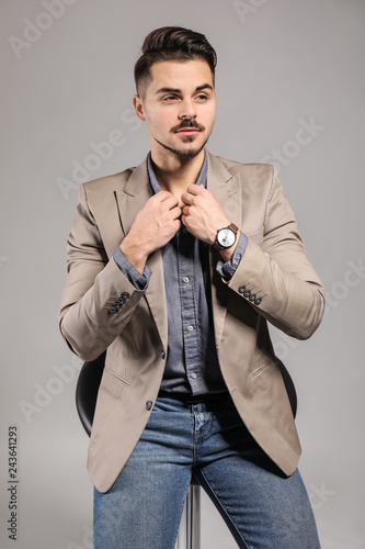 Fotografie, Obraz  Handsome young man on grey background