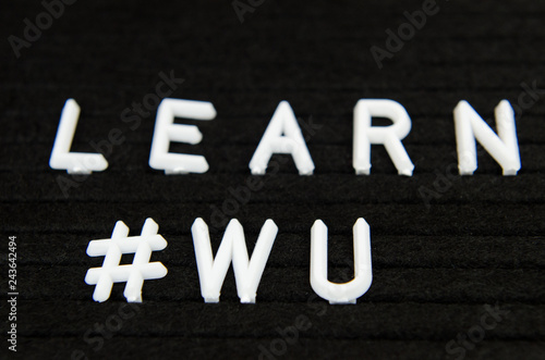 Photo Learn WU CHinese, simple sign on black background, great for teachers, schools,