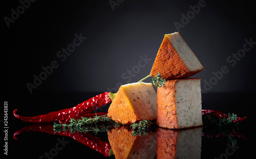 Red Pecorino sheep milk cheese with thyme and red pepper.