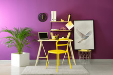 Stylish Workplace With Modern Laptop Near Color Wall