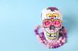 Leinwanddruck Bild - Painted human skull with beads for Mexico's Day of the Dead on color background