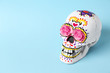 Leinwandbild Motiv Painted human skull for Mexico's Day of the Dead on color background