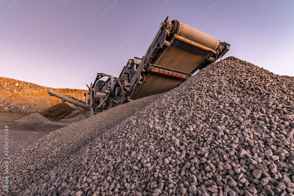 Photo & Art Print Mechanical conveyor belt to pulverize rock and