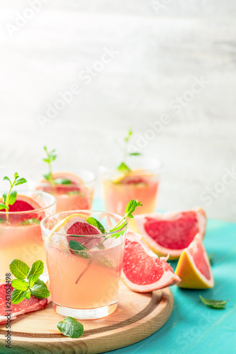 Fotografie, Obraz  Pink alcoholic cocktail with grapefruit, ice and mint