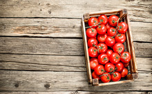 Ripe Tomatoes In A Wooden Box.