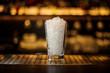 Leinwandbild Motiv Lemonade cocktail glass of crushed ice standing on the empty bar stand