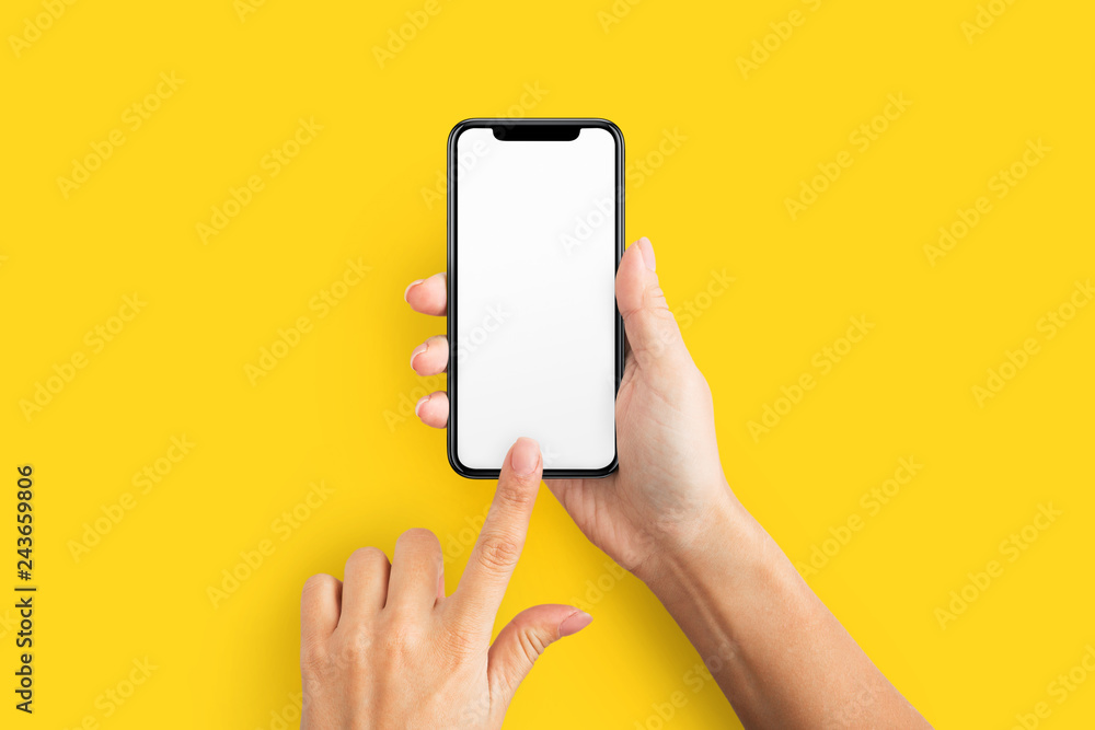 Fototapety, obrazy: Mockup of female hand holding cell phone with blank screen