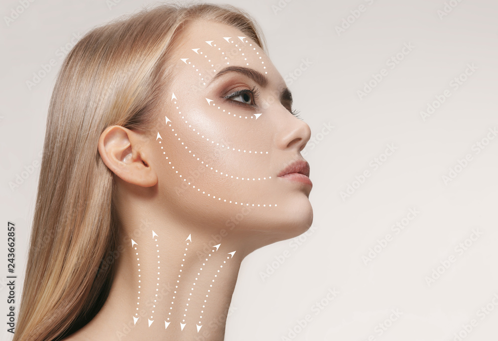 Fototapety, obrazy: Close-up portrait of young, beautiful and healthy woman with arrows on her face. The spa, surgery, face lifting and skin care concept
