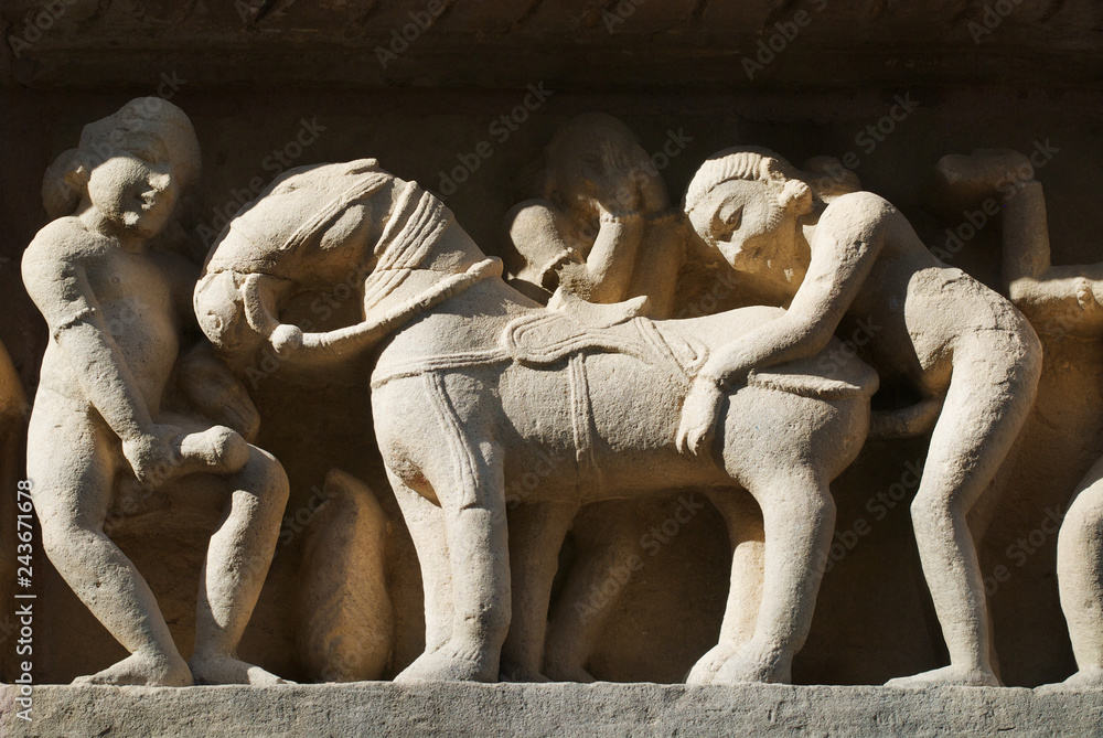 Fototapety, obrazy: Erotic sculptures at Vishvanatha Temple at the  Western temples of Khajuraho in Madhya Pradesh, India. UNESCO World heritage site.