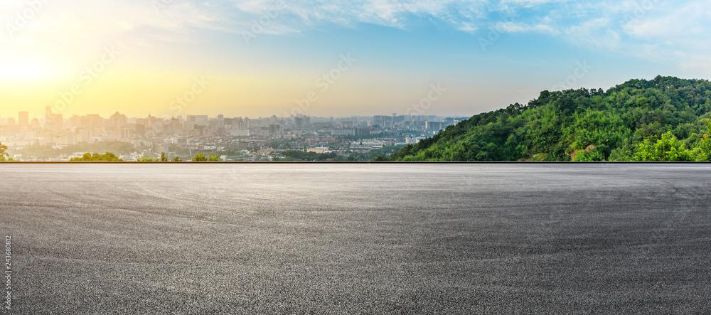 Fototapeta Panoramic city skyline and buildings with empty asphalt road at sunrise